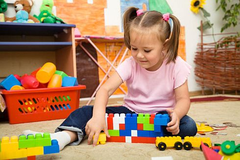 """Pic Courtesy Science Daily saying:  """"Girl at preschool. Supplementing children's diets with fish oil, enrolling them in quality preschool, and engaging them in interactive reading all turn out to be effective ways to raise a young child's intelligence, according to a new report. (Credit: © Serhiy Kobyakov / Fotolia)"""""""