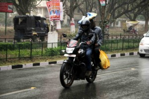 NoteRatan Lal's picture shows a couple moving on a bike facing rain in Ranchi on February 2,2015.