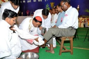 Picture shows Archbishop Telephore P Toppo washing the feet of a follower in Ranchi on Thursday