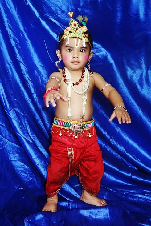 Ranchi, Jharkhand 25 August 2016 :: A child dressed as Lord Krishna participate in a dress competitions on the occasion of Krishna Janmashtami in Ranchi on Thursday. Photo-Ratan Lal