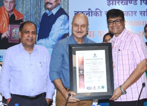 Picture shows film actor Anupam Kher handing over award to Principal Secretary Sanjay Kumar and Director AK Pandey inside Suchna Bhawan in Ranchi on September 2,2016