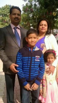 Shows  Jharkhand Anti Corruption Bureau's Additional SP Anand Joseph Tigga,his wife and son