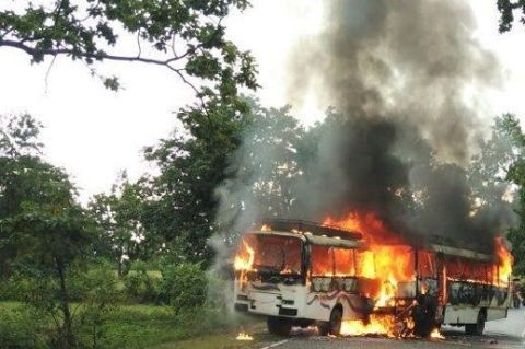 Picture courtesy www.bhaskar.com shows two burnt private buses