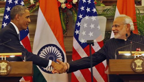 """U.S. President Barack Obama, left and Indian Prime Minister Narendra Modi  shake their hands after they jointly addressed the media after their talks, in New Delhi, India, Sunday, Jan. 25, 2015. Seizing on their personal bond, Obama and Modi said Sunday they had made progress on nuclear cooperation and climate change, with Obama declaring a """"breakthrough understanding"""" in efforts to free U.S. investment in nuclear energy development in India. (AP Photo /Manish Swarup)"""
