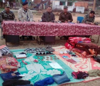 *Picture shows the senior cops including SP,Simdega Rajiv Ranjan with seized items in Simdega on November 28,2016.