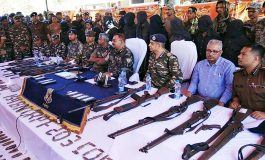 ADG (Operations) RK Mallick alongwith Giridih SP Surendra Kumar Jha and Jharkhand Police and Central Reserve Police Force (CRPF) officers showing recovered arms and ammunitions from Maoists during a press conference at Giridih on Wednesday